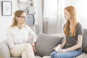 female patient consults with female addiction professional about benzodiazepine taper schedule