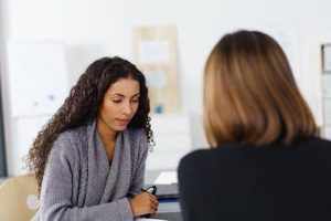 a therapist talks to her patient about a neurobiological integration program in san diego